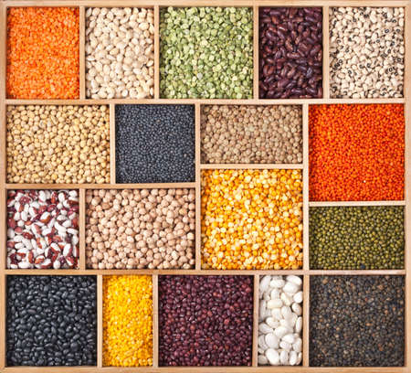 Different beans, peas, lentils and soy in wooden box