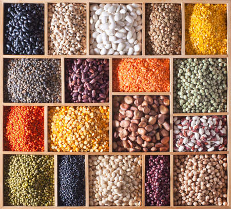 different legumes in a wooden box
