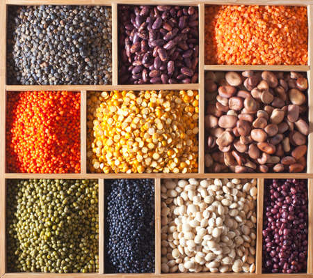 different legumes in a wooden box photo