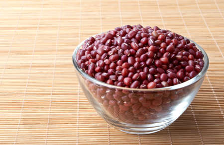 adzuki bean: glass bowl full of adzuki beans Stock Photo