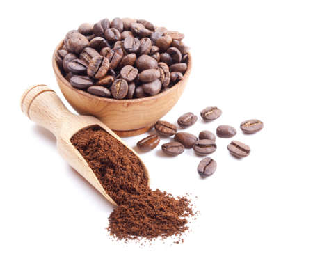 ground coffee and coffee beans isolated on white background photo