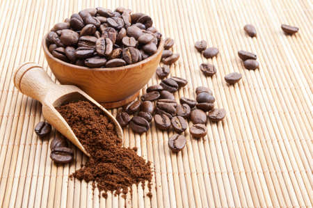 Still life with ground coffee and coffee beans photo