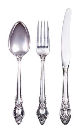 sked: Retro bestick med gaffel kniv och sked isolerad på vitt