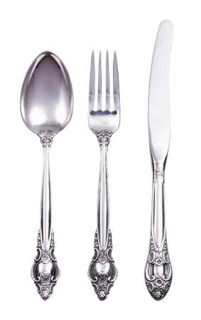 vintage cutlery: Retro cutlery set with fork knife and spoon isolated on white