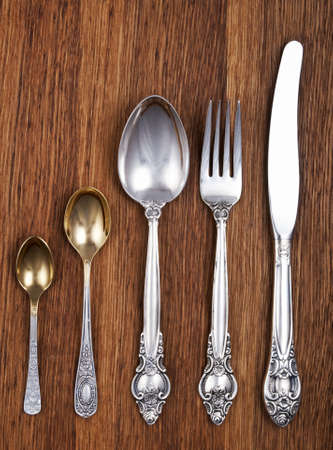 Retro cutlery set on wooden background photo