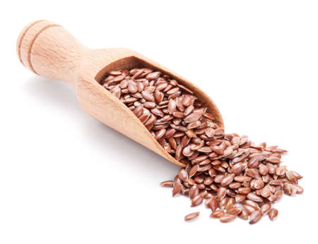 wooden scoop with flax seeds isolated on white background Stock Photo - 15531910