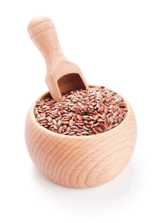 Wooden scoop in bowl full of flax seeds isolated on white background Stock Photo - 15531911
