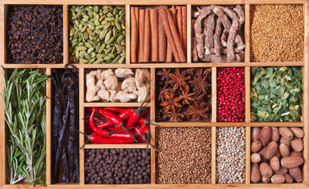 spices and herbs in wooden box