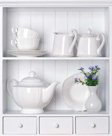 White shelf with vintage porcelain tableware Standard-Bild