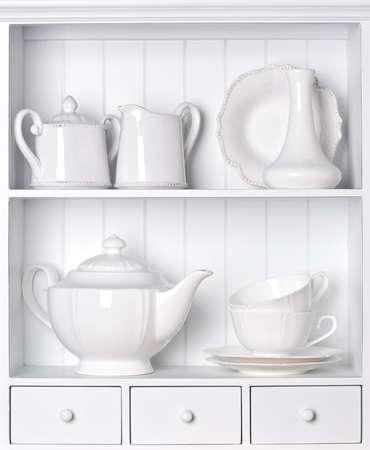 white shelf: White shelf with vintage porcelain tableware Stock Photo