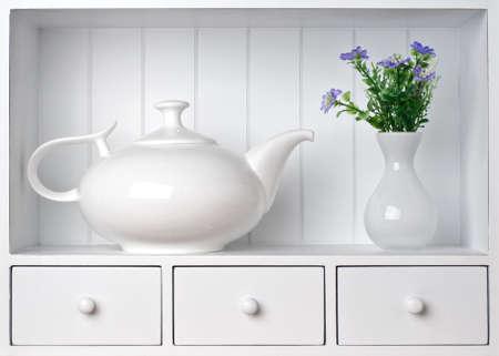 White shelf with vintage porcelain tableware photo