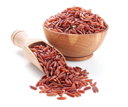 red rice in a wooden bowl isolated on white background