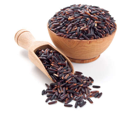 black rice in a wooden bowl isolated on white background