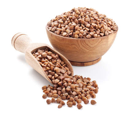 buckwheat in a wooden bowl isolated on white background Stock Photo