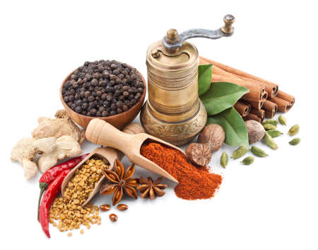 still life with spices and herbs isolated on white background