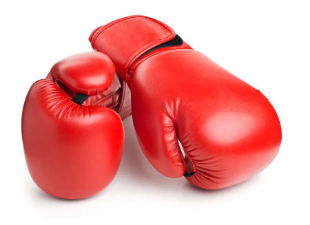 boxing training: red leather boxing gloves isolated on white background