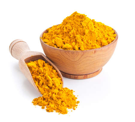 ground turmeric isolated on white