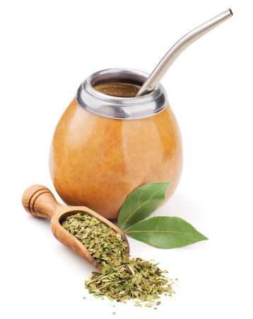 mate drink: scoop with dry mate tea and calabash isolated on white