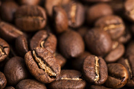 medium closeup: Close-up of medium roasted coffee beans. Blurred background. Small DOF
