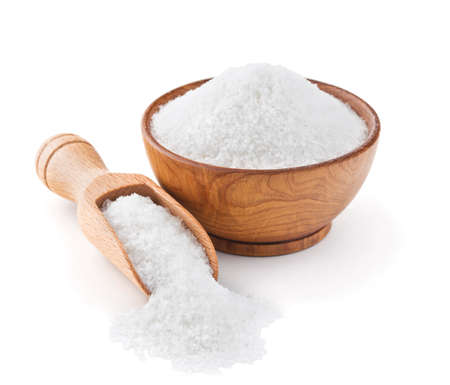Regular table salt in a wooden bowl isolated on white background 写真素材