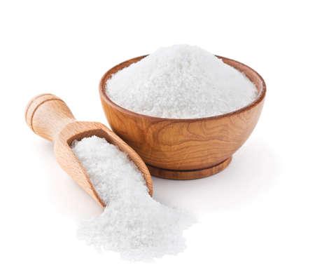Regular table salt in a wooden bowl isolated on white background Standard-Bild