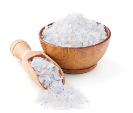 mineral salt: Persian blue salt in a wooden bowl isolated on white background Stock Photo