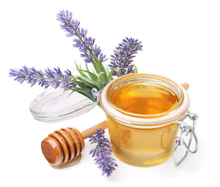 drizzler: jar of liquid honey with lavender. artificial flowers