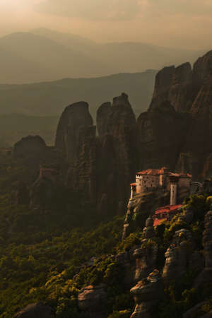 meteora: Dark dramatic landscape of monastery in Meteora mountains. Greece
