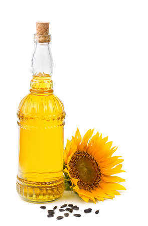 a sunflower: sunflower oil and seeds isolated on white background