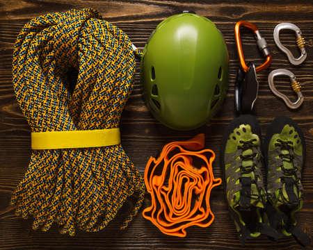 extreme sports: set of basic climbing equipment on rough wood background Stock Photo