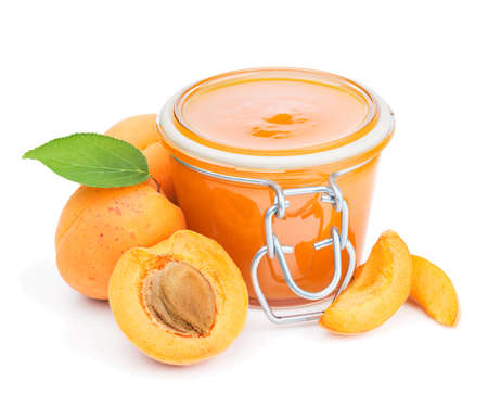 apricot jam: Apricot jam and fresh fruits isolated on white background Stock Photo