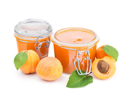 apricot jam: Two jars of apricot jam and fresh fruits isolated on white background Stock Photo