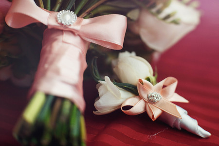 boutonniere: close-up images of beautiful wedding bouquet boutonniere