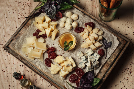 kinds: different kinds of cheese on a wooden plate Stock Photo