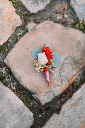 boutonniere: wedding boutonniere on a vintage Stock Photo