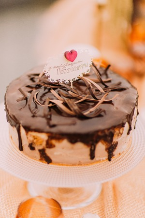 tempting: Sweet tempting wedding cake on beige background close up.