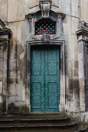 spanish architecture: Famous landmark in Spain. Beautiful cathedral Mezquita of Cordoba, Andalucia. Green door with arch in old arabic style. Traditional spanish architecture. Religious and tourist place in Europe. Stock Photo