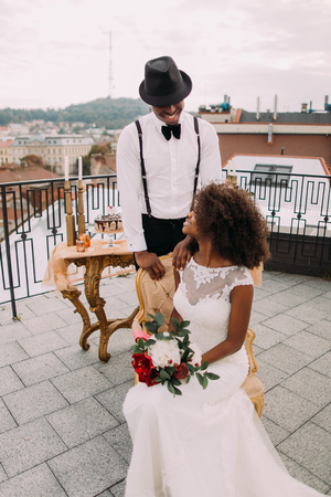 beatuful: Beatuful newlyweds lovingly look at each other on the rooftop.