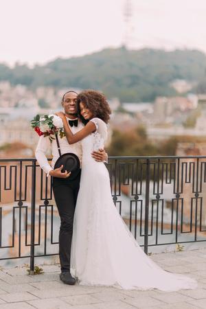 black woman white man: Beautiful african wedding couple on their wedding day.