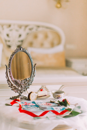 vanity table: Beautiful white vintage table with mirror in victorian style. Tea time.