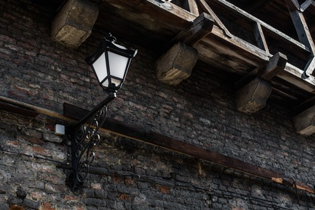 plafond: Old lantern on the stoned wall of ancient castle. Stock Photo