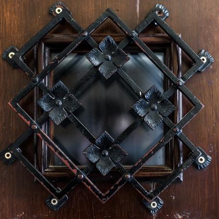 latticed: Beautiful latticed window on wooden background close up. Stock Photo