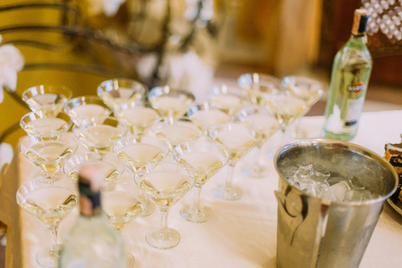 drinks on bar: Martini glasses in the form of a cascade or pyramid at the wedding party.