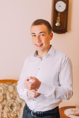 cufflinks: Close up of businessman wearing cufflinks. Elegant young fashion business man