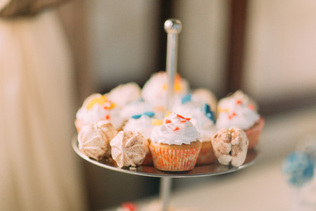 ingest: Cute cupcakes on tier at wedding reception. Stock Photo