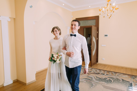 concluded: Happy groom and bride walking hand in hand  at civil registry office where  concluded their marriage. Stock Photo