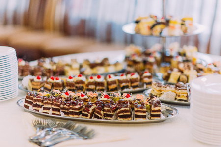 chocolaty: Close-up view collection of delicious assorted mini dessert standing on a table in restaurant. Stock Photo