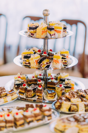 chocolaty: Collection of delicious assorted mini dessert standing on a table in restaurant.