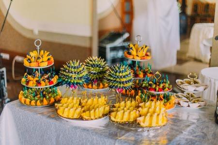 heathy diet: Delicious sliced fruit for dessert on wedding table.