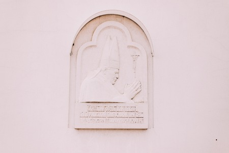 memorial plaque: Memorial plaque dedicated to Pope John Paul II on the wall Nativity of the Theotokos Church in Lviv, Ukraine.